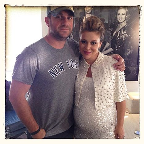Counting down the days! Pregnant Alyssa Milano showed off her growing baby bump while posing with her husband David Bugliari. The actress stunned in a fitted silver sequined dress with an embellished ivory cape. Lovely!