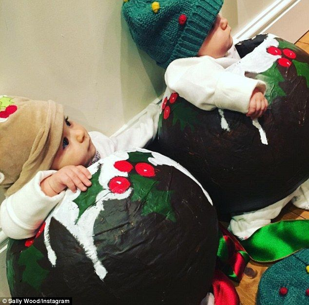 Festive fun! Ronnie Wood, 69, and his wife Sally, 38, were every inch the proud parents as they dressed their twin daughters in adorable Christmas pudding outfits on Sunday