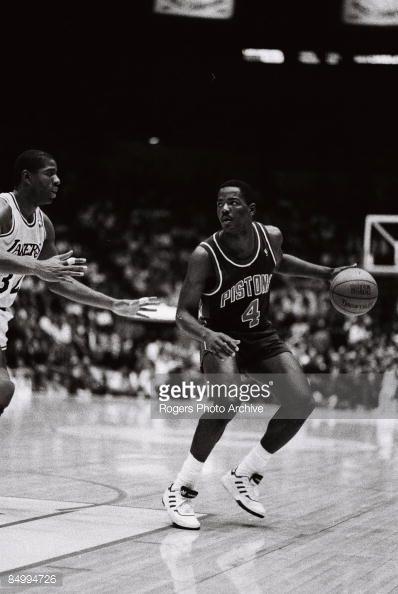 Fotografia de notícias : Joe Dumars of the Detroit Pistons brings the ball...