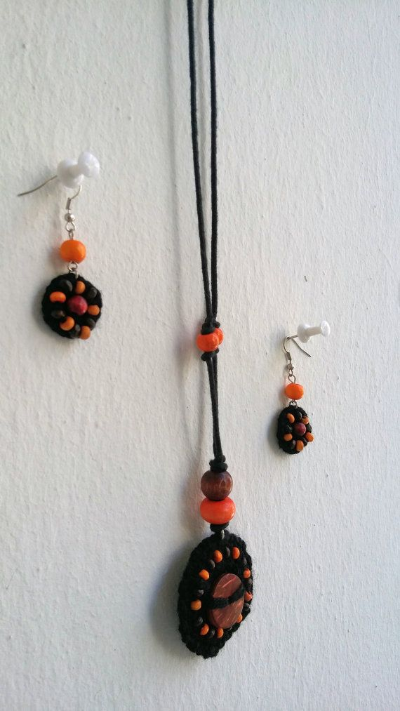 Hand knitted black-orange necklace-earring set by KirkeCraft