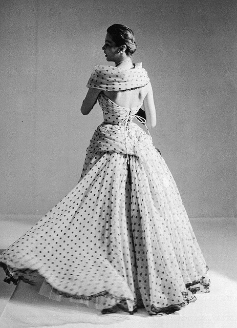 The back view of a tremendously pretty polka dot evening dress. 1953
