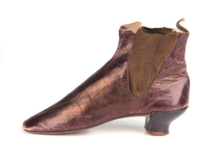 1840-1870 ca. Brown Boots, British.  Ladies brown glacé leather ankle boots with elasticated sides and curved heels. An example of elastic used mid 19th Century.