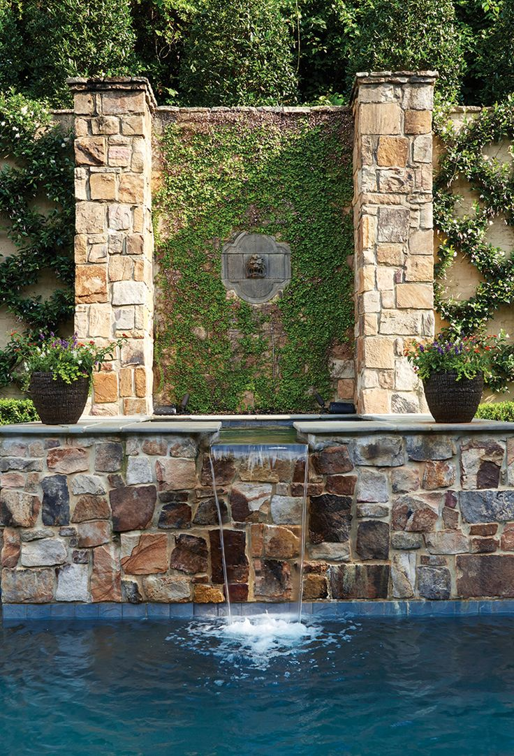 Pool with a stonework fountain. #outdoor #living