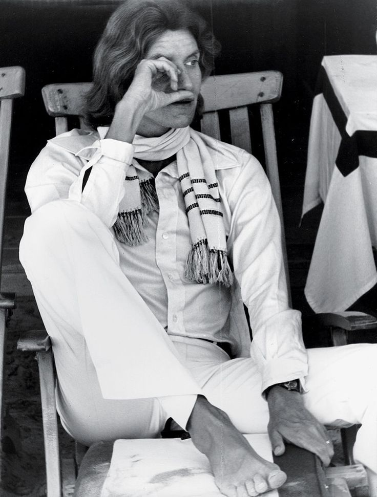 "Yves Saint Laurent in Venice, early 1970s ""I took this snap of Yves at Giovanni Volpi's cabana at the Lido during the Venice Film Festival. Yves was one of the most mischievous friends I have ever had. He was extremely naughty and very endearing and sensitive."""