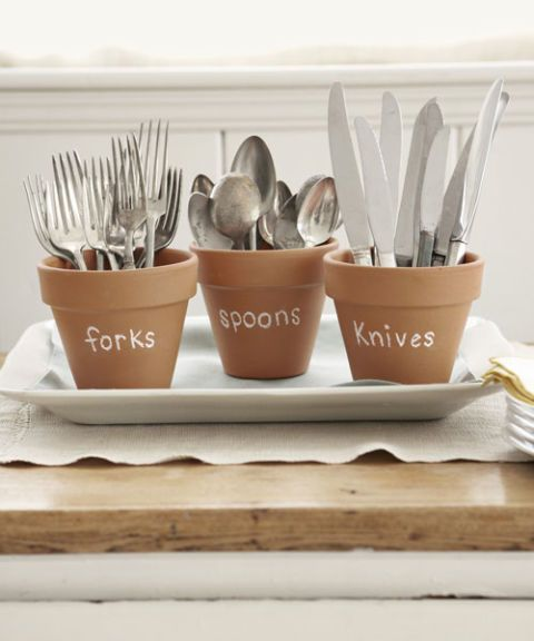 Set silverware out in pretty terra-cotta pots. Label each container using chalk, so you can wipe off the writing and reuse the pots.