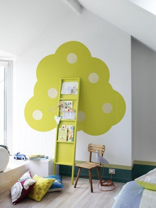 super cute wall art / bookshelf tree in a kid's room
