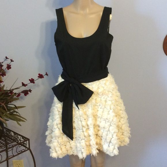 Asos party dress Worn once, beautiful full cream rosette skirt with black knit top. Ultra comfortable.mpair with the perfect black heels and minimal jewelry and it's a classic! ASOS Dresses
