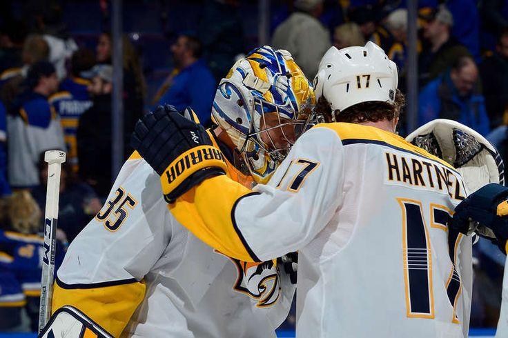 ST. LOUIS, MO - DECEMBER 27: Pekka Rinne #35 of the Nashville Predators celebrates with Scott Hartnell #17 after the Predators defeated the St. Louis Blues at Scottrade Center on December 27, 2017 in St. Louis, Missouri. (Photo by Jeff Curry/NHLI via Getty Images)