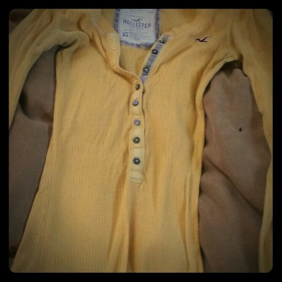 Long sleeve yellow shirt Yellow tight fitted and buttons half way down. Great for layering Hollister Tops