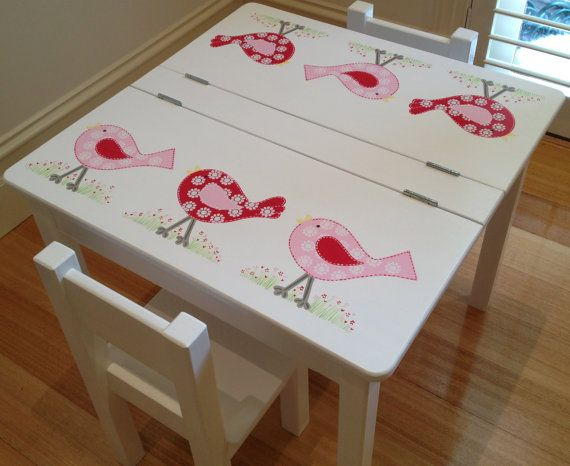 Hand made and hand painted childrens desk and chair set. This is a listing for a childs desk and two chairs, painted in our bird design. This desk has hinged tops, creating a storage space underneath to place all those work in progress masterpieces, pencils etc. There is a small gap at front sides of the desk to prevent little fingers being caught. An internal safety hinge can be attached if requested, which would incur an additional cost. The desk legs are removable to allow for…
