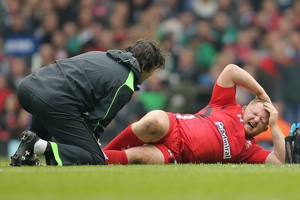 Samson Lee shows the pain as he receives treatment before leaving the field with an injury against Ireland