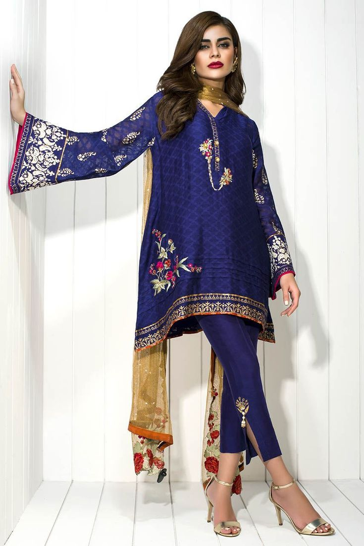 Cotton net self printed shirt featuring embroidery and  block print along the sleeves and the hemline.