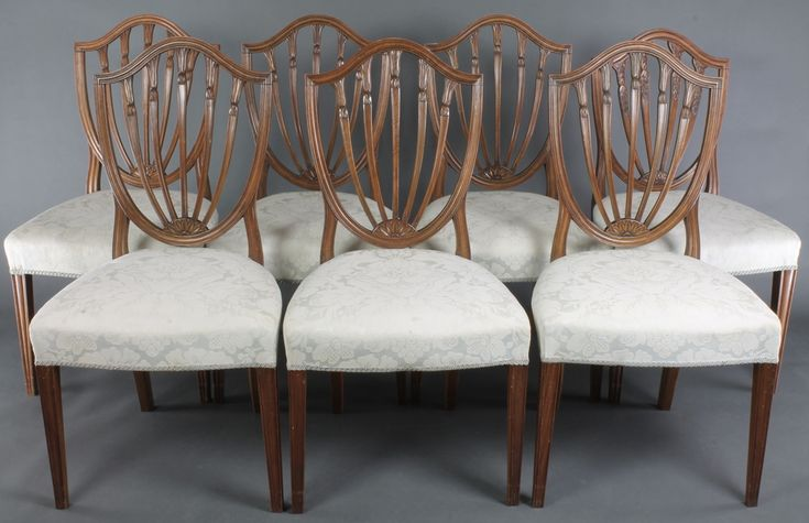 Lot 839, A set of 6 and 1 very similar 19th century Hepplewhite style shield back carved dining chairs with over stuffed seats, raised on square tapered supports, est £500-700