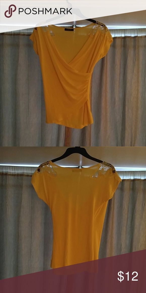 Beautiful yellow V neck blouse Gorgeous detailing on the shoulder. Low cut and looks great on  Excellent condition Deb Tops Blouses