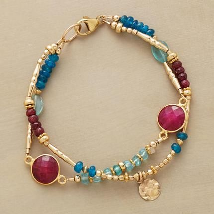 """RUBY BLUES BRACELET Ruby rounds in golden rims are spotlights amid a two-blue mix of apatites, smooth and faceted. Paillettes and a variety of 14kt goldfill beads lend their glow. Lobster clasp. Sundance exclusives handcrafted in USA. Approx. 7-1/2""""L."""