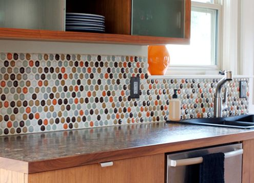 bolder round tile kitchen backsplash. orange, white, blue, browns