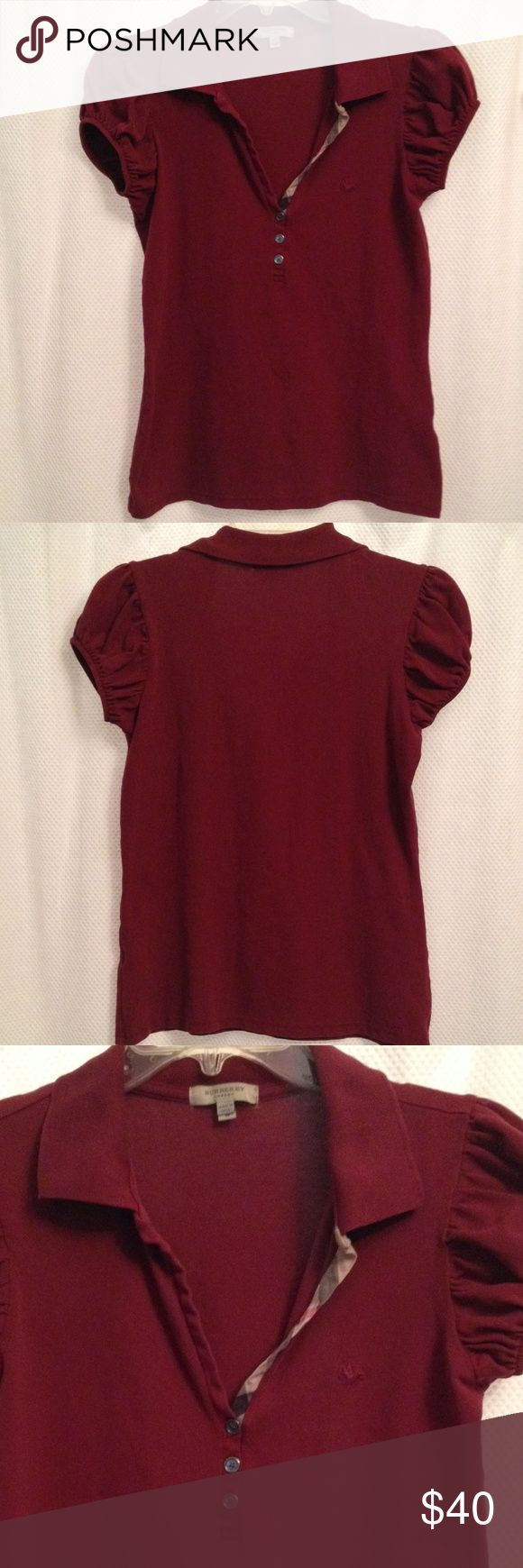 Cranberry Burberry polo shirt with puff sleeves Cranberry polo shirt by Burberry with puff sleeves.  Signature Burberry print detail is featured on the neckline.  This shirt does not button, so it has a V neckline. Size M Burberry Tops