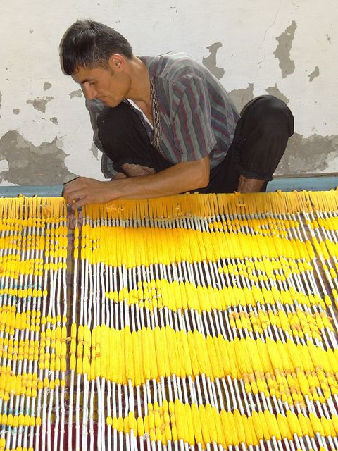 Man Threading Yellow Silk - Ikat. Yodgorlik Silk Factory - c. Margilon - Uzbekistan.