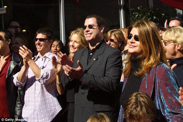 Tom Cruise, Kelly Preston, John Travolta and Kirstie Alley listen to actress Jenna Elfman speak at a Church of Scientology event