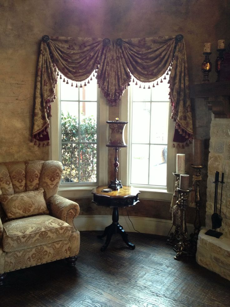 Round room, swags and Jabot with tassel trim, faux finished wall treatment. Old World