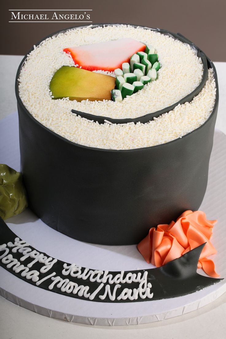 Sushi Anyone? #62Food  Sushi anyone? This cake is ideal for anyone who loves a california roll! The cake is wrapped in fondant and then decorated with with sprinkles and fondant to look like the real thing.