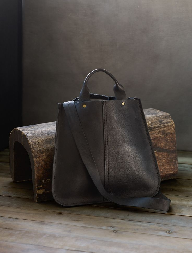Description This modern shape is a luxurious piece for everyday wear. Created in collaboration with Haiti Design Co, the hand stitching on this bag ensure that it will last for years to come. Details