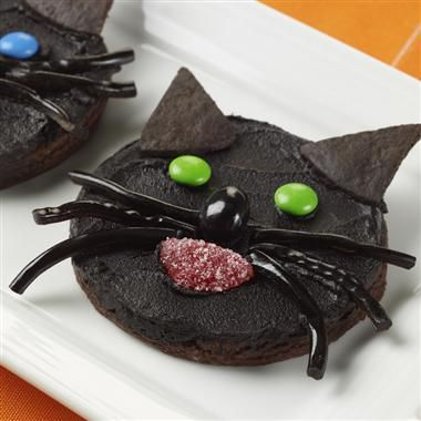Beware the black cat crossing your path – unless it's a rich chocolate-frosted cookie decorated as a frightful feline.