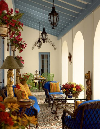 ntricately patterned Mediterranean tiles create a welcoming floor in this loggia. A weather-resistant floor is a great way of adding pattern when an area rug isn't practical.