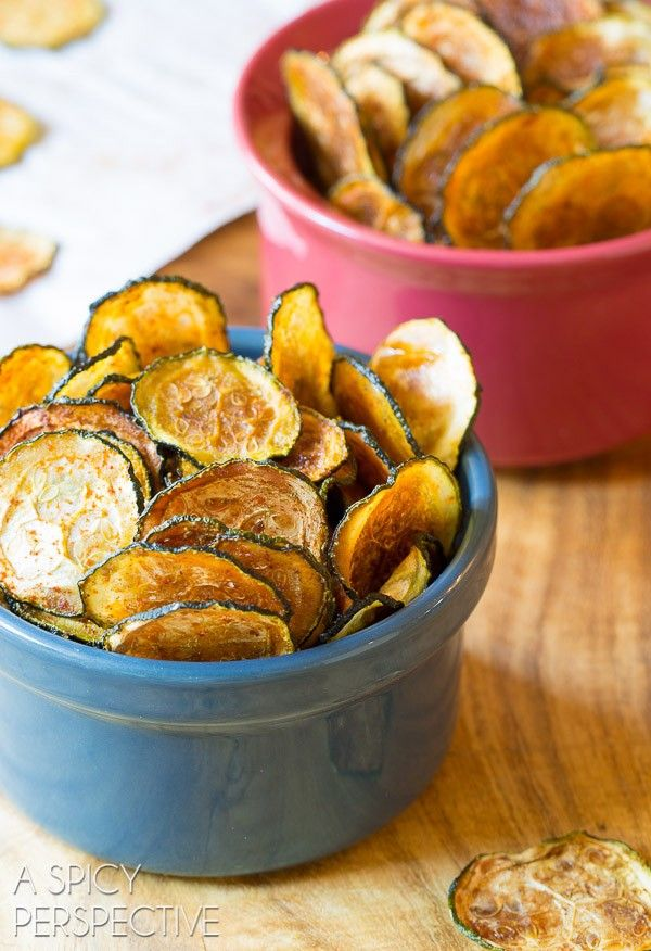 Crispy Baked Zucchini Chips. A healthy paleo-friendly snack recipe that is loaded with flavor and crunch. Baked Zucchini Chips with smoky paprika and cumin
