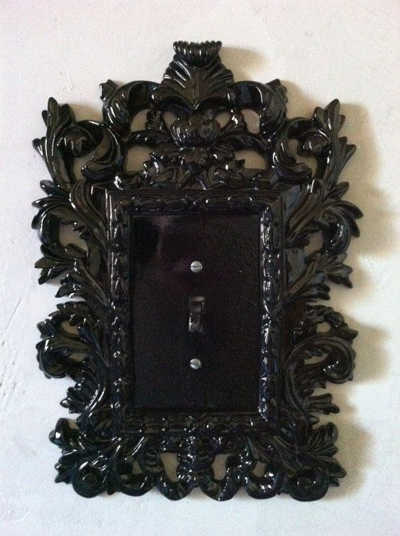 Needa figure out how to make this on my own...change all my light switch covers to black ones and find a mini ornate frame to mount over em and paint that black? (: