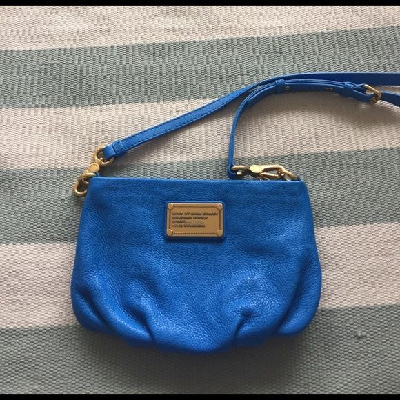 "NWOT Blue Marc by Marc Jacobs Crossbody Handbag This NWOT gorgeous blue Marc by Marc Jacobs crossbody handbag is perfect for any occasion can fit a wallet and any sized iPhone. 100% genuine leather with gold plaited hardware detailing and removable strap if you want to wear it as a clutch. In excellent condition never worn does not include tags or dust bag. W=9.5"" H = 6.5"" Strap Height/Length =23"" Marc by Marc Jacobs Bags Crossbody Bags"