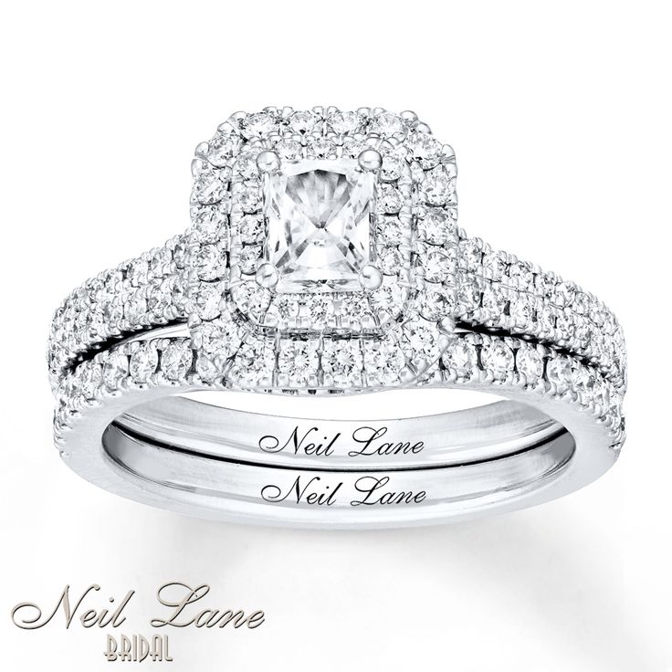 Dazzling rows of round diamonds surround a spectacular radiant-cut diamond center to create the main attraction in this stunning bridal set from Neil Lane Bridal®. The 14K white gold band of the engagement ring and matching wedding ring gleam with twinkling diamonds, bringing the total diamond weight of the bridal set to 1 1/8 carats. Neil Lane's signature appears inside each band. Diamond Total Carat Weight may range from 1.115 - 1.14 carats. Diamond Total Carat Weight may ...