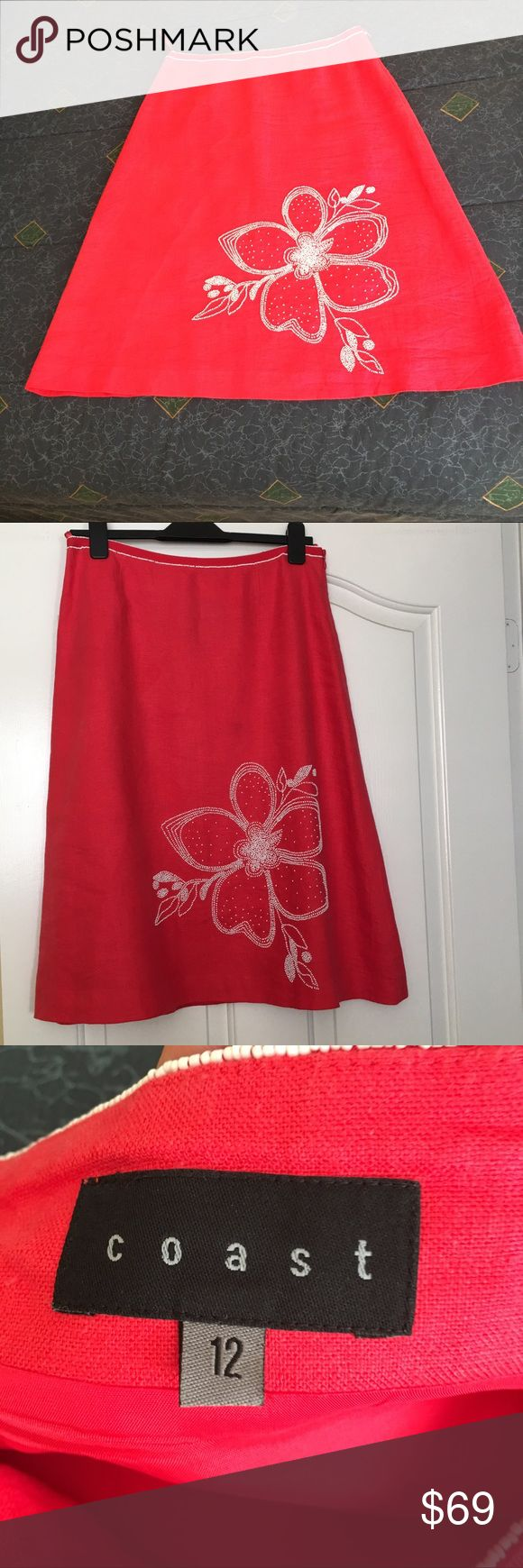 """British Coast 100% linen beaded skirt This is a gorgeous A-line skirt by the British fashion brand """"Coast"""". It is bright red in color, 100% linen and lined inside. There is a hand-sawn beaded flower on its left side. There are 2 rows of beading on the waist. It is a size 12 U.K. (size 8 US). It will fit someone with a 30 inch waist. Purchase for $380. Unfortunately too small for me now. There is a tiny stain 5 inches below the waistline (please see the last photo) barely noticeable when…"""