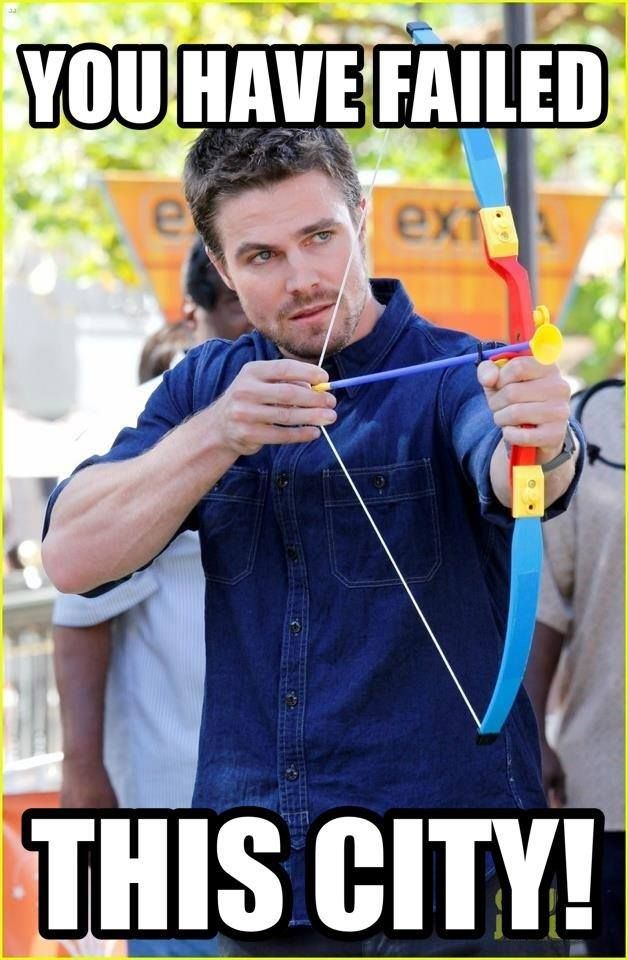 Stephen Amell using a different bow and arrow than Oliver Queen usually uses...lol.