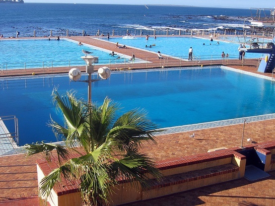 Huge swimming pools at Sea Point, Cape Town, South Africa. Sea Point is one of Cape Town's most affluent and densely populated suburbs, situated between Signal Hill and the Atlantic Ocean.  Go to www.YourTravelVideos.com or just click on photo for home videos and much more on sites like this.