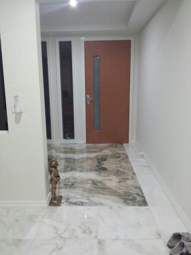 Marble feature floor tiles in the hallway entrance foyer of our client's beautiful new home