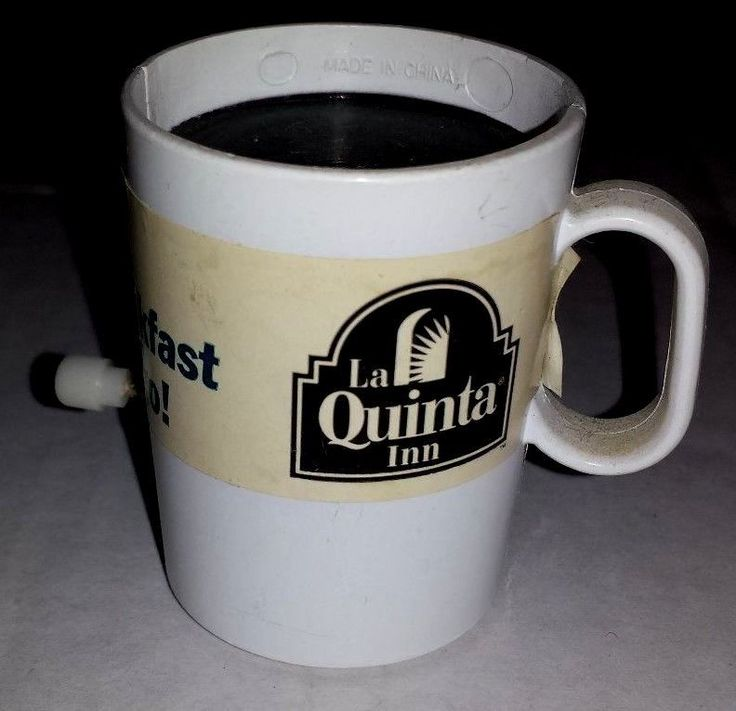 """VINTAGE LA QUINTA INN WIND-UP ADVERTISING SPINNING COFFEE CUP 2"""" HEIGHT"""