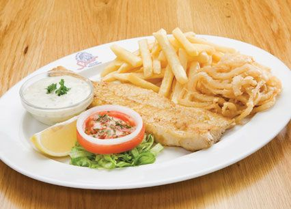 Hake & Chips. Lightly dusted and grilled or flash-fried. Served with tartare sauce at Spur Steak Ranches | http://www.spur.co.za/menu/chicken-schnitzel-seafood