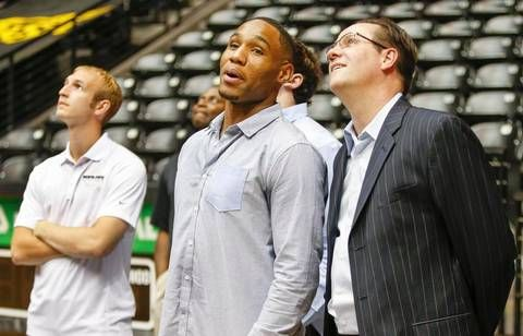 Wichita State coach Gregg Marshall and senior Tekele Cotton like what they see as the watch a highlights clip on the big screen at the WSU basketball awards celebration at Koch Arena Thursday. (April 16, 2015)