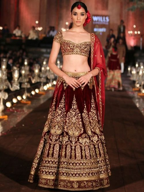 #RohitBal showcased an exquisite maroon lehenga as part of his Gulbagh collection earlier this year