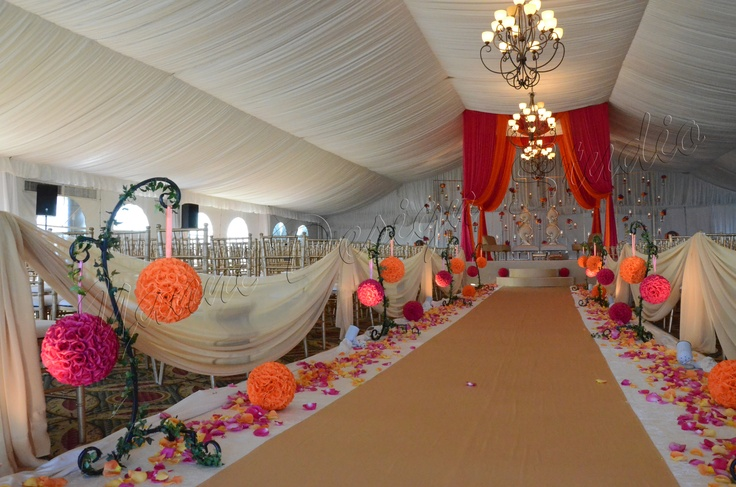 aisle lined in hot pink and orange kissing balls