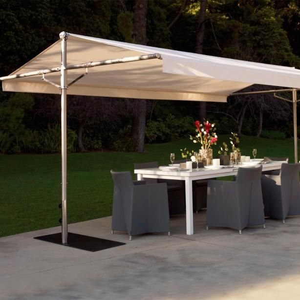 Create a spacious, shaded oasis for seating or dining with our Papillon Shade. Papillon's rectangular canopy is held firmly in place by a         durable frame that withstands moderately strong winds (lower the shade in severe or inclement weather). Fully opened, the canopy shades         overhead sun; or, partially close the canopy for early morning or late afternoon sun.                             Frame in either stainless steel or eucalyptus-enhanced stainless steel           ...