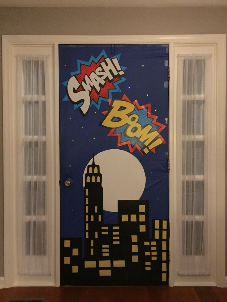 Super hero birthday party - front door decorated as a backdrop for photos