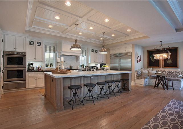 Floors are solid french white oak stained on site with a custom color.