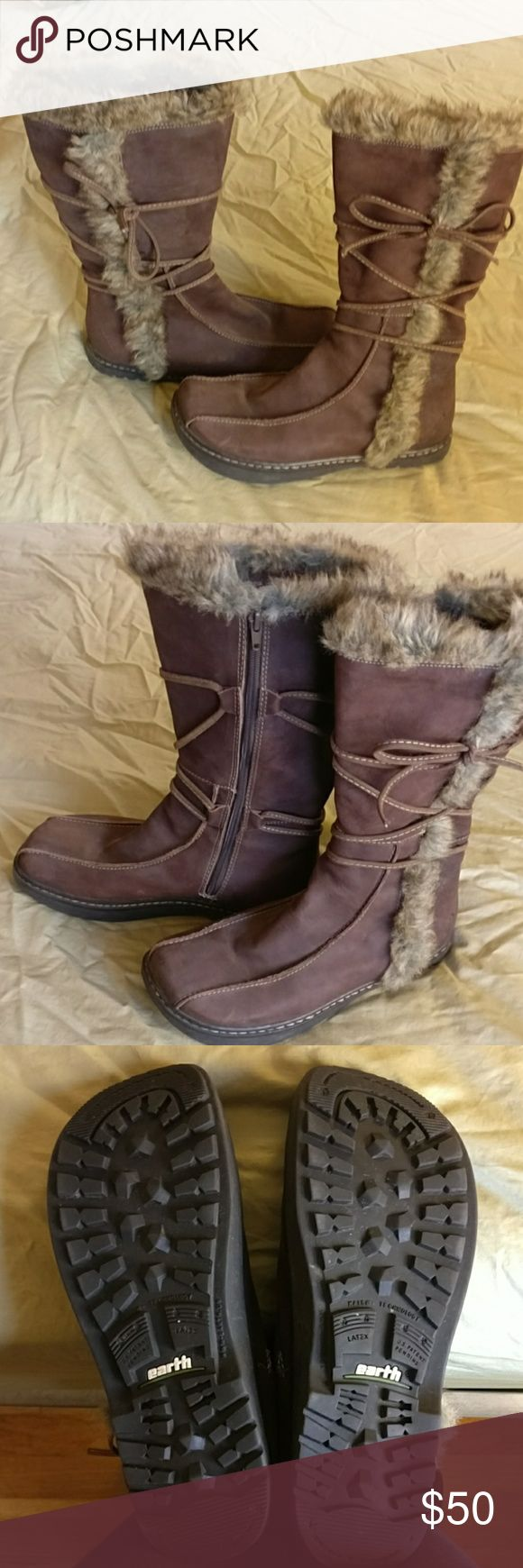 Earth leather winter insulated boots 9 Earth winter insulated leather boots w faux fur trim. Slightly negative heel makes these extremely comfy, very warm worn twice, EUC, not cold enough here for them. Earth Shoes Winter & Rain Boots