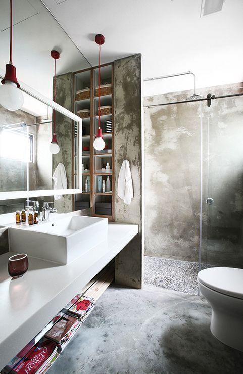Banheiro decorado com piso e paredes de cimento queimado