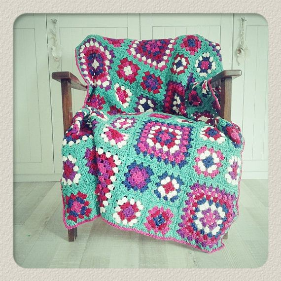 Cheerful crochet granny square blanket.