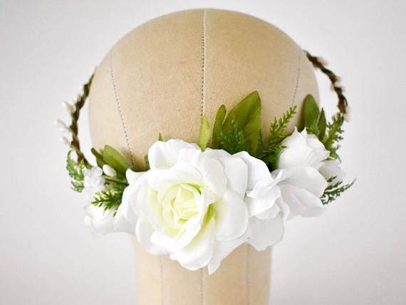 Gorgeous white roses and delphiniums and lush greenery adorn this lovely floral crown. The rustic base is covered with natural bark and intertwined with white berry vines. This half crown is designed to give the wearer more options in the placement of the flowers. It may be worn with the silk flowers resting on either the left or right side of the head, or in the back, perhaps over a veil. The crown will be made to 22 inches, unless other measurements are sent, and, upon request, it may be…