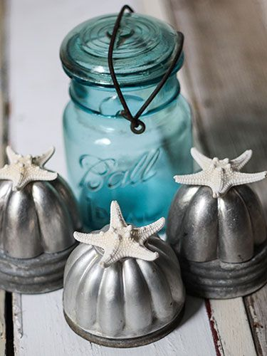 Starfish sit atop vintage Jello molds for a charming beachy display