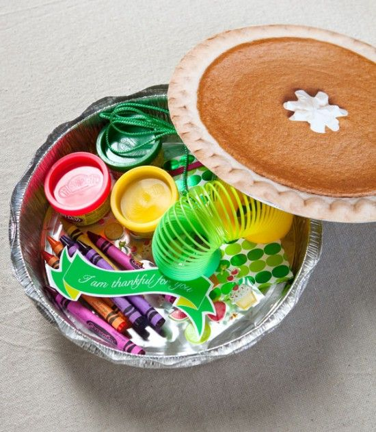 """Faux Pumpkin Pies. Use as Thanksgiving place cards, when the kids open up their """"pie,"""" a variety of toys and fun activities will be waiting!"""